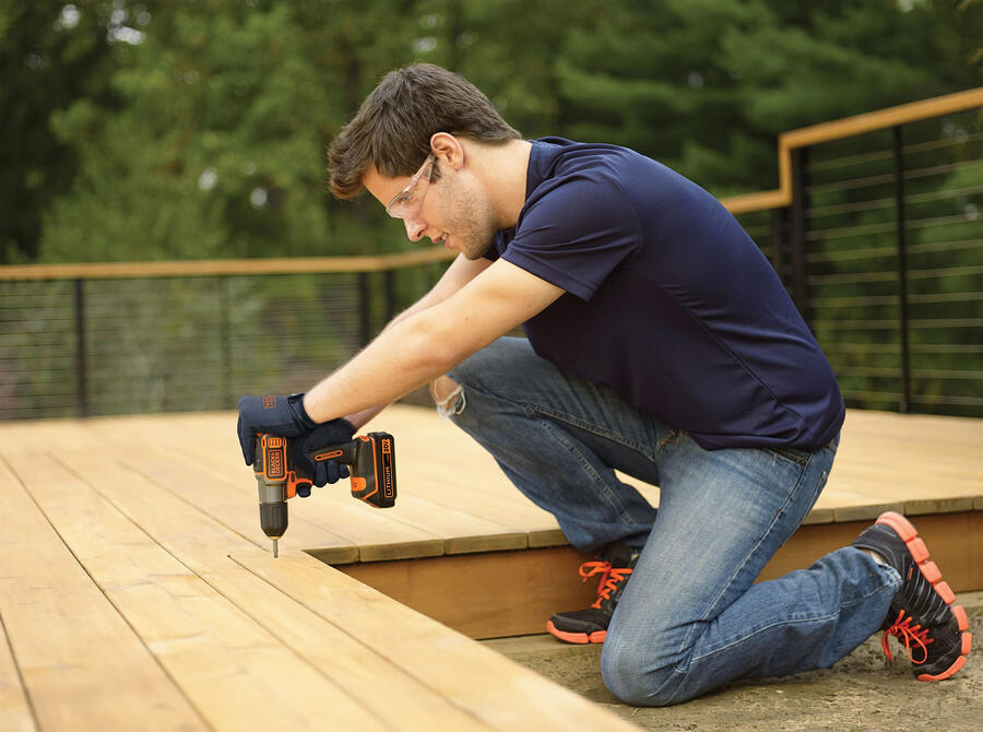 man building a deck